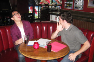 Two employees share a private moment during our pub crawl team building course