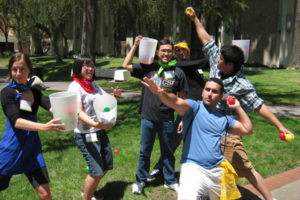 Students display some of the game equipment for our team building challenge No Match Catch