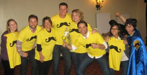 A successful team building event often wraps with everyone in yellow shirts