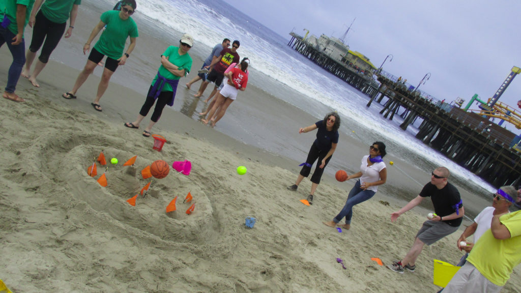 Team Building on the beach? Look no further than Wise Guys Events and our Beach Play Stations team building program