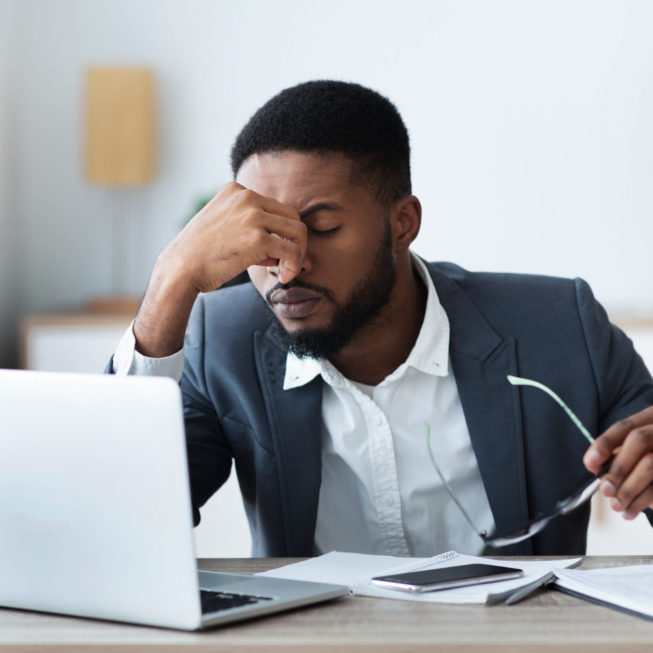 African businessman working remotely frustrated team member needing team building exercises